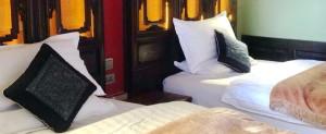 Shaxi Yunnan hotel beds at Old Theatre Inn - Shaxi China